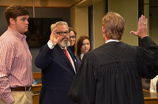 Brady receiving the oath of office